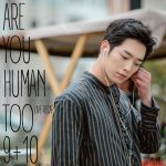 Seo Kang Joon puts ear phone in his ear in Are You Human Too