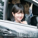 Seo Ye-ji smiling at the camera from inside a car in Lawless Lawyer