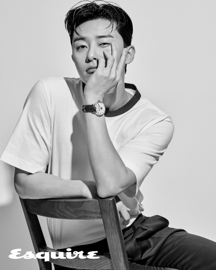Black and White image of Park Seo-joon in a chair