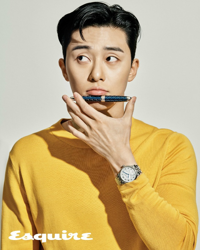 Park Seo-joon in a yellow shirt with an ink pen