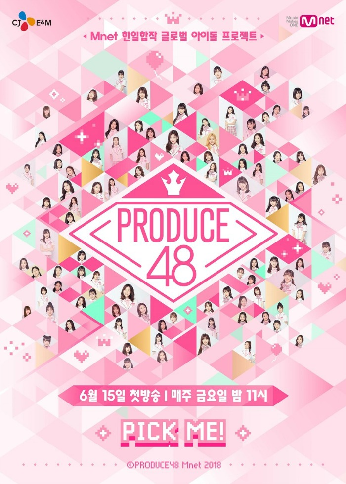 Pink poster for produce 48 showcasing all the contestants in pink green and yellow diamonds