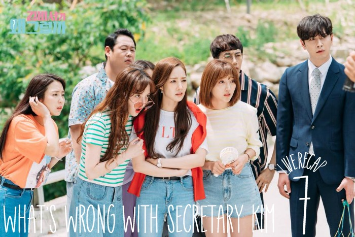 Outside at a park a lot of office workers stare at something shocking in Secretary Kim