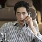 Seo Kang-joon wearing a button up shirt and on the phone in Are You Human Too