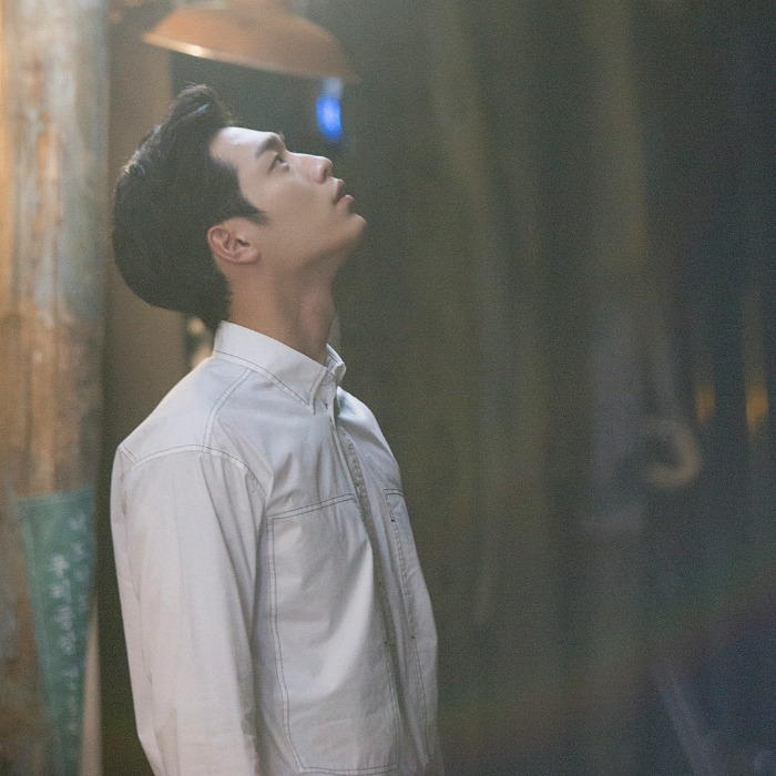 Seo Kang-joon wearing a white button up and looking up at something off screen in Korean drama Are You Human Too