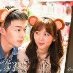 Jin Ki-joo and jang Ki-yong wearing bear ear head bands at a theme park