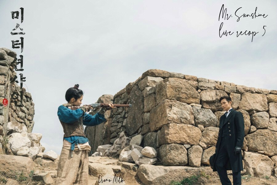 Kim Tae-ri is holding a gun to Lee Byung Hun in Mr. Sunshine