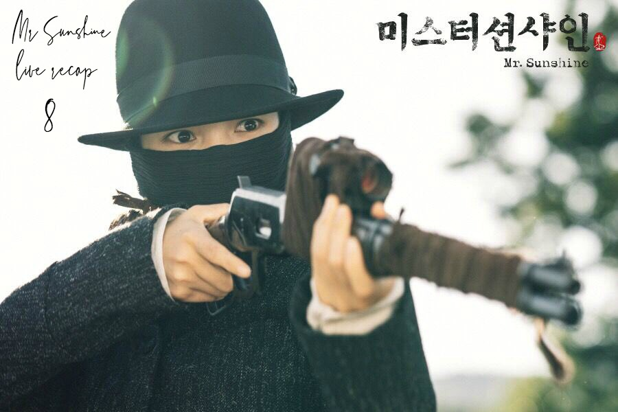 Kim Tai-ri in all black and pointing a gun in Mr. Sunshine