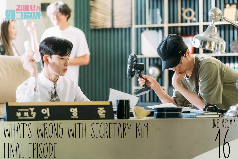 Park Seo Joon is getting fanned by the director as he sits behind his desk in a Behind the scenes shot of What's Wrong With Secretary Kim