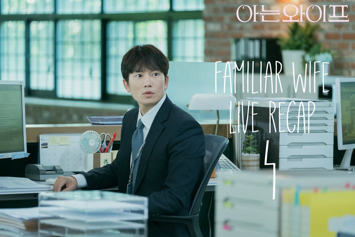A man working in a bank behind a desk in the Kdrama romantic comedy Familiar Wife