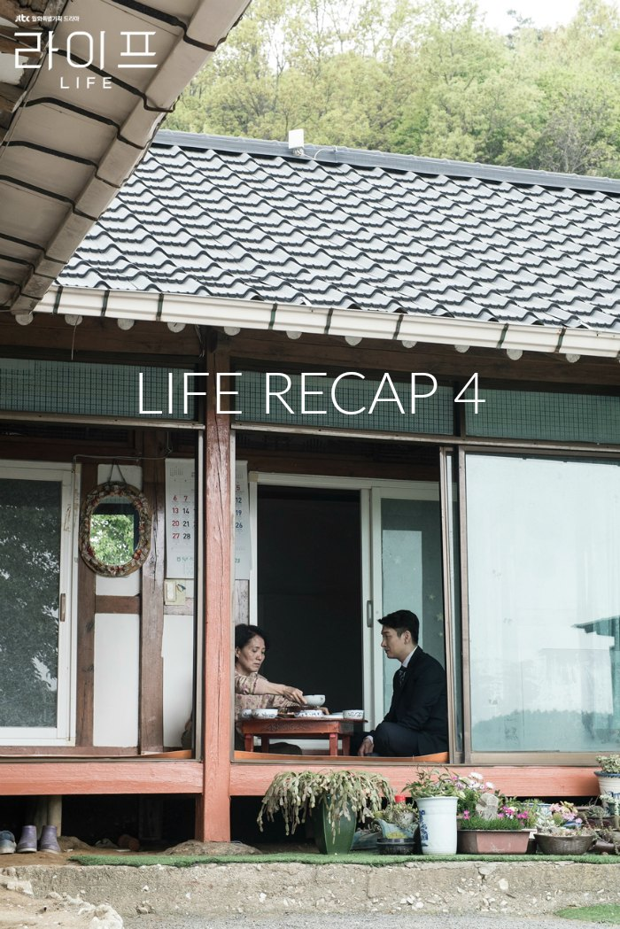 A man and a woman eating in a Korean style home in the countryside in the Kdrama Life