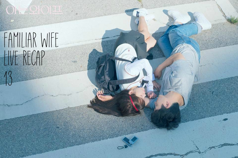 The main characters laying in the street knocked out in Familiar Wife Korean drama