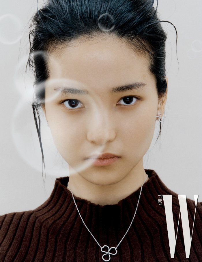 Kim Tae Ri (김태리) with bubbles and a brown sweater and a delicate necklace for W Korea magazine