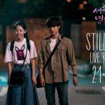 Two main leads walking on the sidewalk in Korean drama Still 17