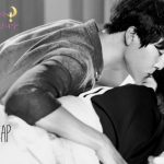 A man kisses a woman on the forehead in kdrama Still 17