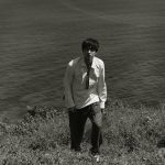 Gong Yoo walking on a beach in Esquire Magazine