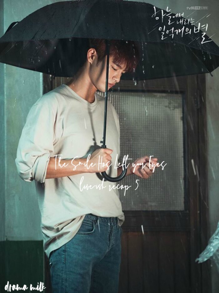 Seo In-guk standing in the rain holding an umbrella in Kdrama The Smile Has Left Your Eyes