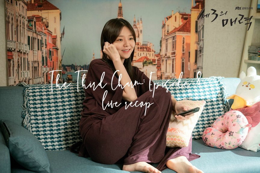 Esom sitting on a couch happily chatting on the phone