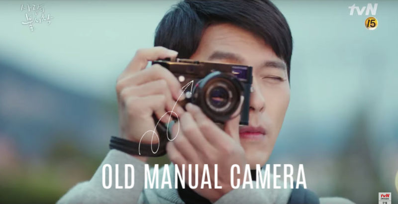 A manual camera in what I think is the younger scene, though it could be unrelated.