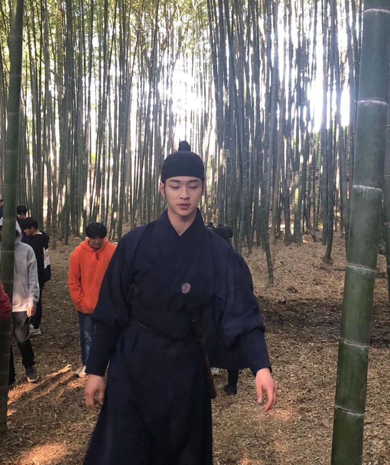 Jang Dong Yoon behind the scenes in the bamboo forest for the Kdrama The Tale of Nokdu