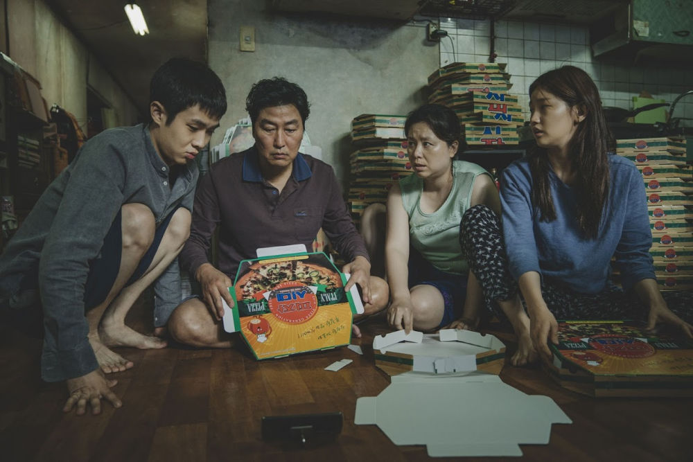 Choi Woo Sik, Song Kang Ho, Jang Hye Jin, and Park So Dam in Korean movie Parasite